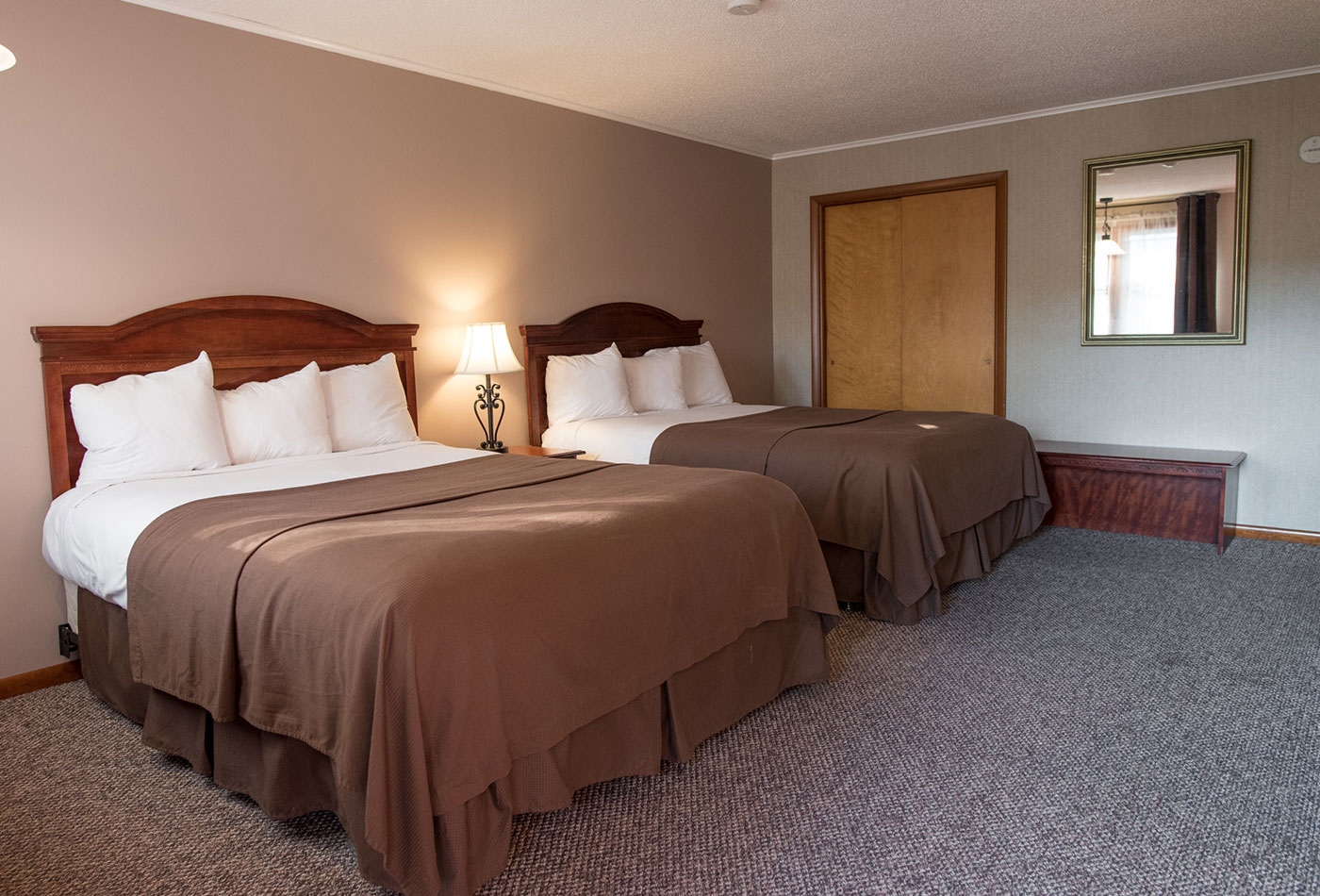 Lake George Double Queen Guest Room with beach access at Dunham's Bay Resort