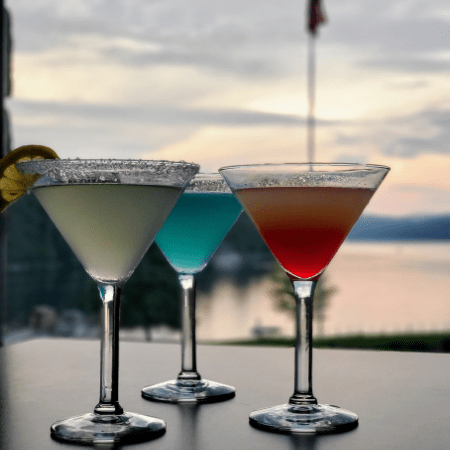 Three martinis with sunset in background